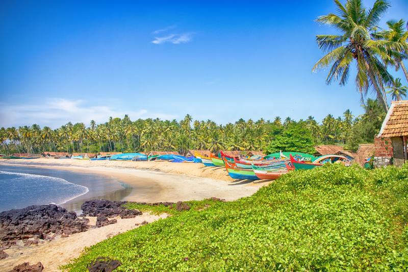 Arabian sea in Kerala and Goa, painted boats, palm trees and san stock image