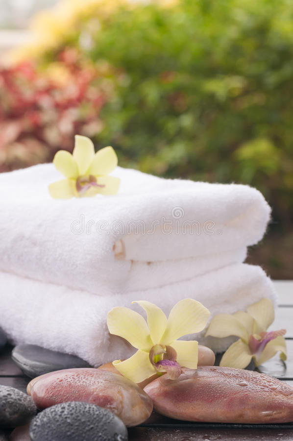 Exotic spa holiday with orchids and river stones. Close up stock photo