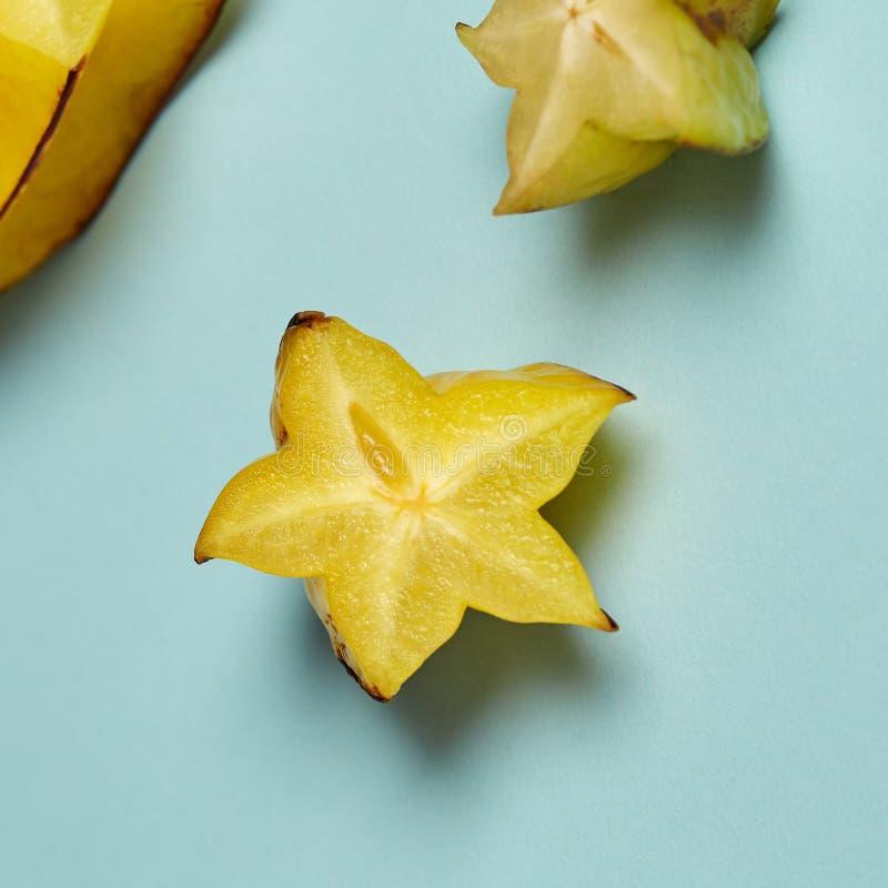 Exotic starfruit slice or carambola on on blue background, flat lay royalty free stock photos