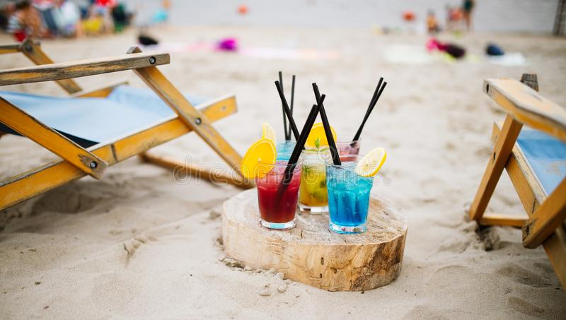 Exotic summer drinks , blur sandy beach on background. Vacation concept royalty free stock images