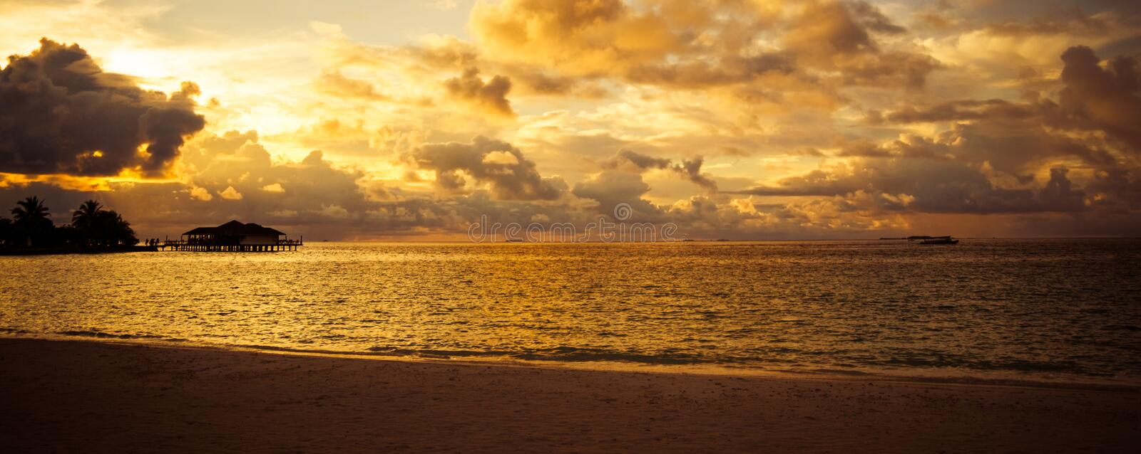 Exotic Sunset. Sunset beach and beautiful clouds. Maldives background concept stock photos