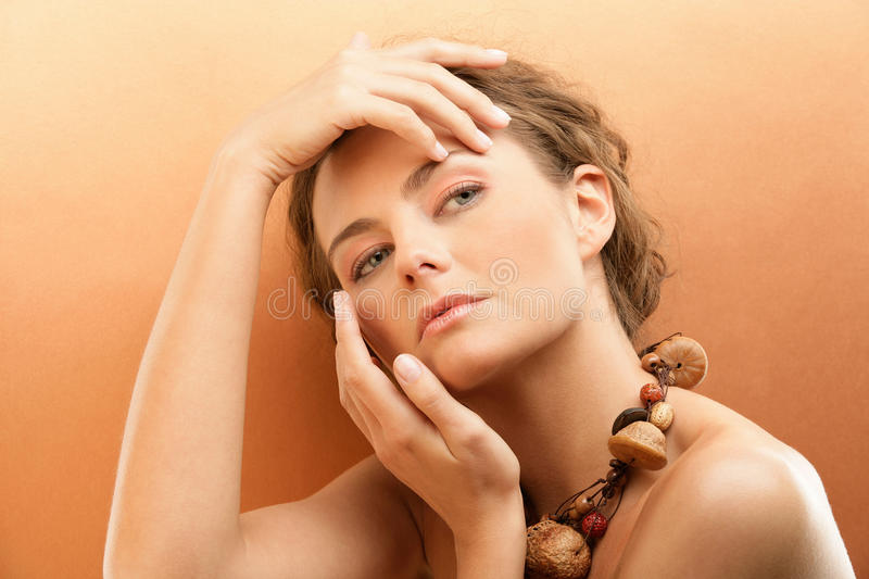 Download Exotic Tanned Woman Touching Face Stock Photo - Image: 13874532