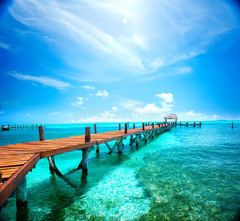 Exotic tropical resort. Jetty near Cancun, Mexico. Travel, Tourism and Vacations Concept royalty free stock photography