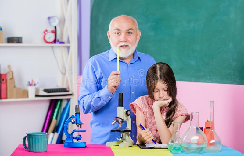 Expand your mind. Chemistry and biology. Teacher help schoolgirl. School lesson. Good pedagogue friendly kind. Little stock photo