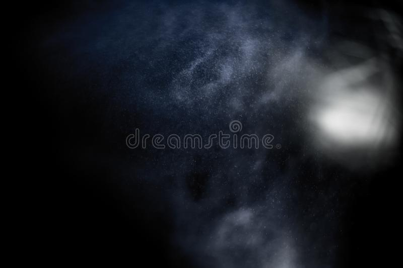 ``Expanding galaxy``. `Expanding galaxy`, planets and stars in vortex. Bizarre atmosphere of light, fine particles and bright halos royalty free stock photo