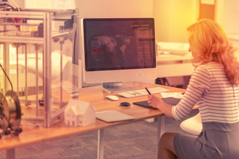 Diligent employee tracking down international office locations. stock images