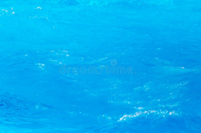 Expanse of blue water in the pool as a background stock photography