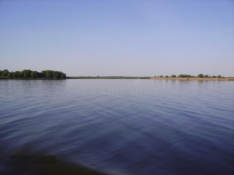 Expanse of the Don River, southern Russia. Blue water and blue summer sky. Primeval nature. stock images