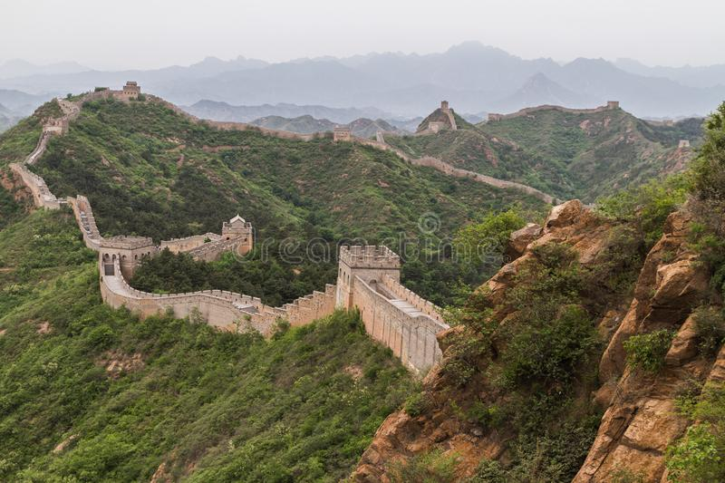 Great Wall of China. The expansive Great Wall of China in the hills and mountains royalty free stock photo
