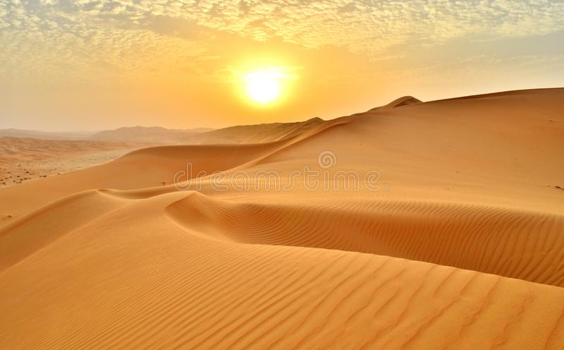 Expansive Sand Dunes in the Arabian Desert at Sunset. Sunset at the Edge of the Rolling Sand Dunes in the Empty Quarter Arabian Desert outside Abu Dhabi, United stock photos