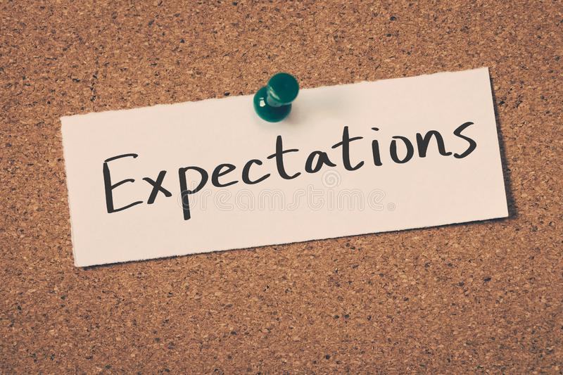 Expectations. Concept word on a cork board royalty free stock images