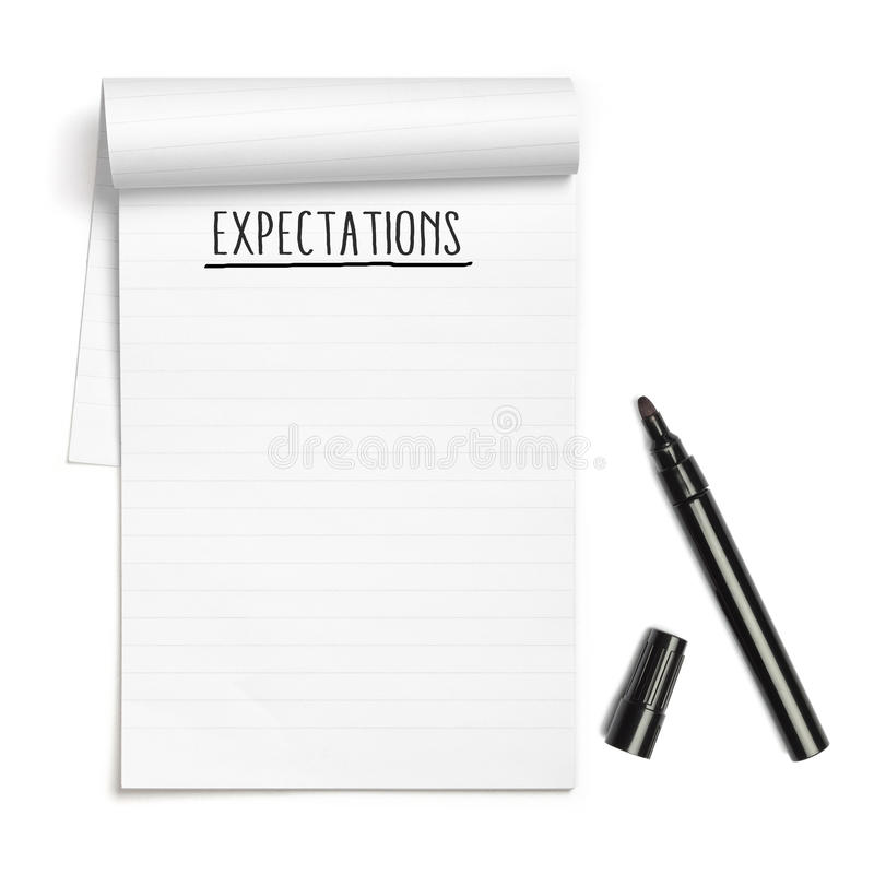 Expectations on note book with black pen. With copy space, isolated on white background stock photo