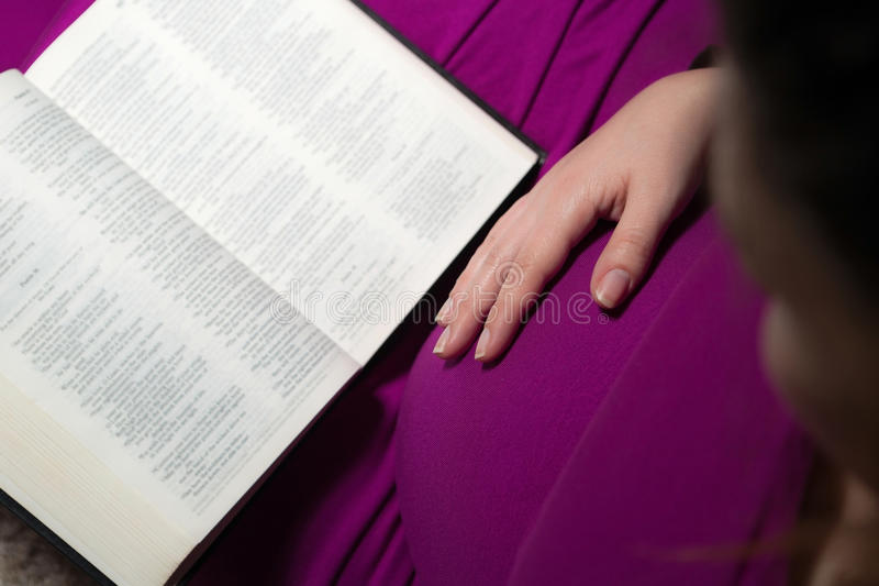 Expecting Mom Holding The Holy Bible royalty free stock photo