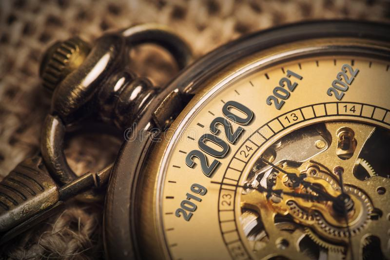 Expecting the new year 2020 with a metaphor of ticking pocket watch royalty free stock images