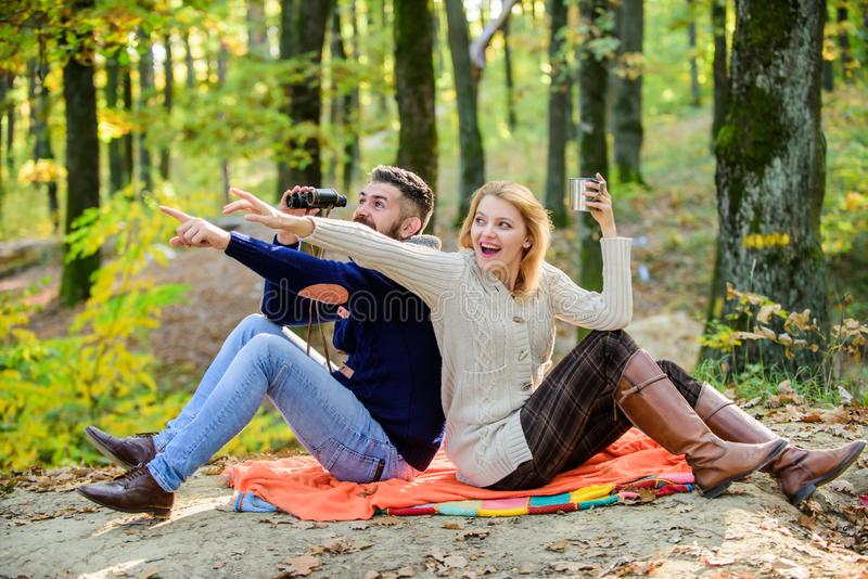Expedition concept. couple in love relax in autumn forest with tea or coffee. Family picnic. camping and hiking stock photography