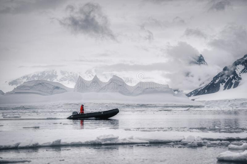 An expedition man reaching shores of Antarctica stock photos