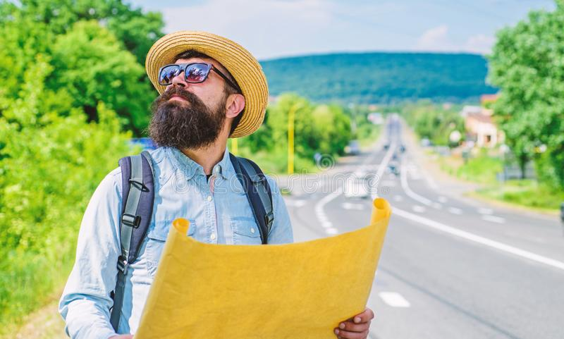 Expeditor backpacker map look direction travelling. Around world expedition. Map helps find right direction if get lost royalty free stock photos