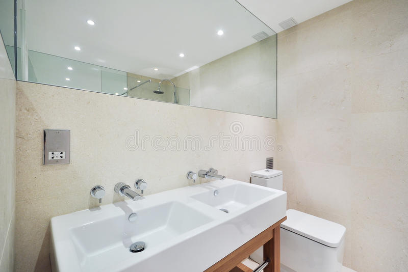 Expensive bathroom. Expensive family bathroom with double sink and stone tiles stock photos