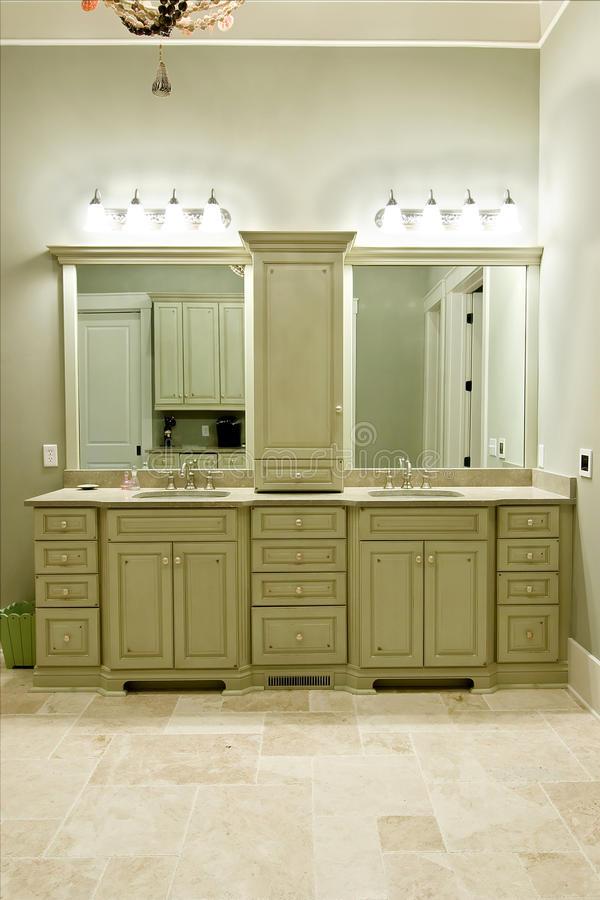 Expensive bathroom cabinets. Custom cabinets with double sink in expensive bathroom remodel stock images
