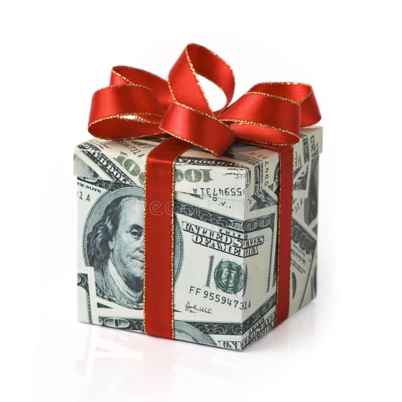 Expensive gift. A gift box covered in US money with red colored ribbon applied royalty free stock photography