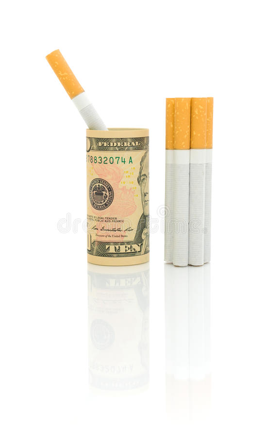 No smoking. Cigarettes and money on white background. Expensive habit. No smoking. Cigarettes and money on white background. Vertical photo stock photos