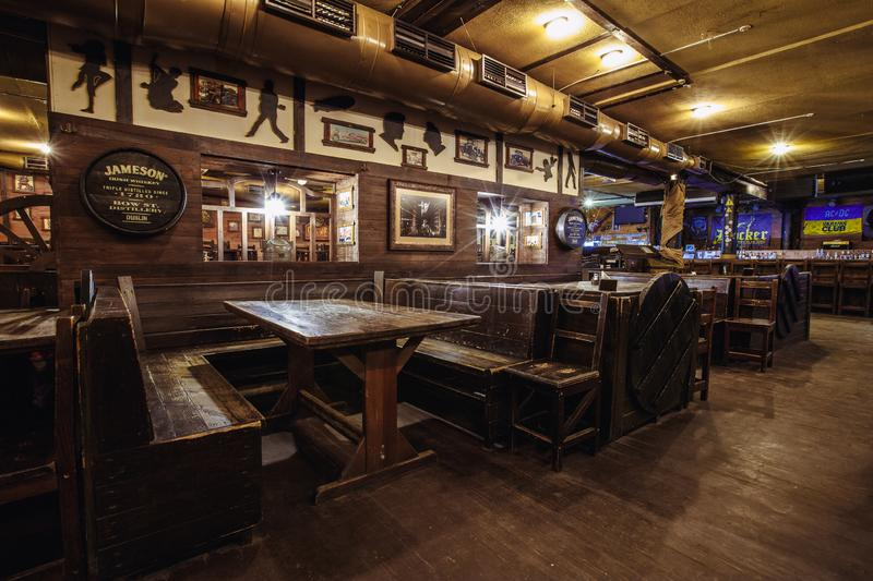 Expensive interior of the Irish pub. Kiev, Ukraine- March 19, 2018.  wooden chairs stand at large wooden tables in an Irish pub pub. nightclub party place for stock image
