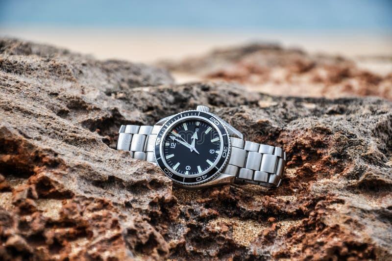 Expensive swiss wrist watch on a rock - Molokai, Hawaii stock images