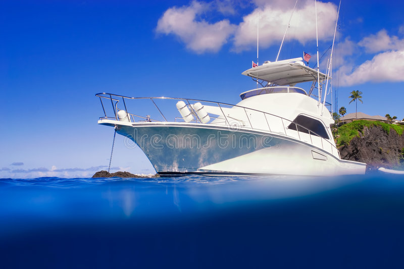Expensive Yacht. In Bright Blue Tropical Ocean stock images