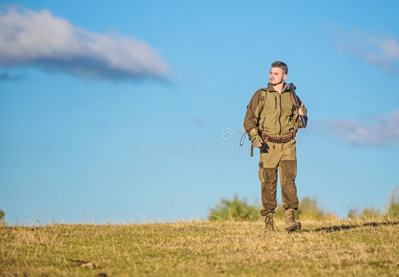 Experience and practice lends success hunting. Hunting weapon gun or rifle. Hunting hobby. Guy hunting nature royalty free stock image