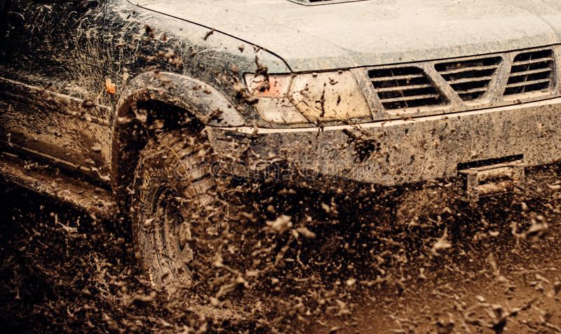 Experience some truly challenging terrain. Offroad car in action. Car racing offroad. Dirty car drive on high speed. SUV. Or offroader on mud road. Car wheels royalty free stock photos