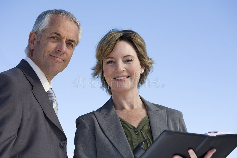Experienced business couple royalty free stock photography
