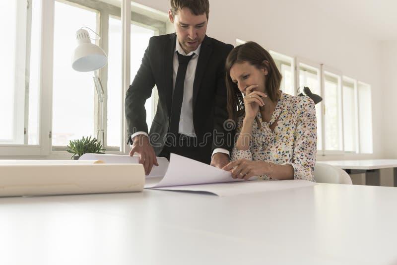 Experienced businessman analyzing blueprints stock photos