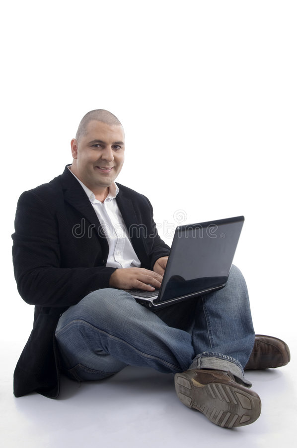 Experienced businessman working on laptop. On an isolated background stock photos