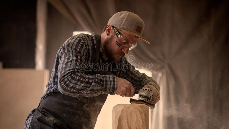 Experienced carpenter saw sculpture stock images