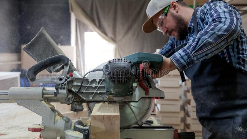 Experienced carpenter work with circular saw stock images