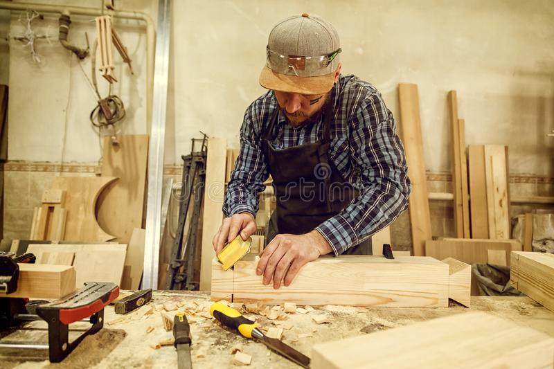 Experienced carpenter in workshop royalty free stock photos