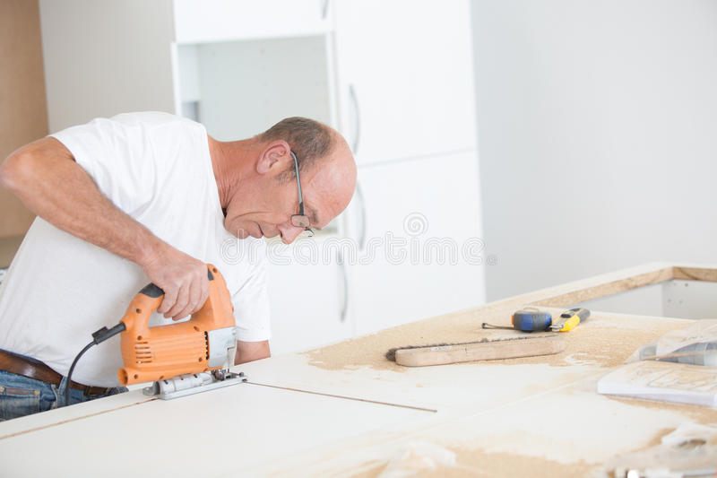 Experienced carpenter working on project stock photography