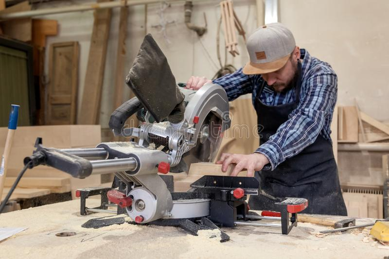 Experienced carpenter working royalty free stock photo