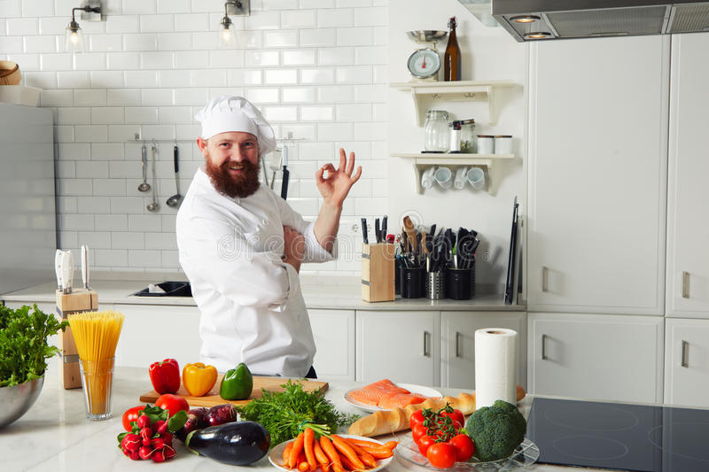 Experienced chef making ok sign standing on the kitchen for Fresh chef kitchen