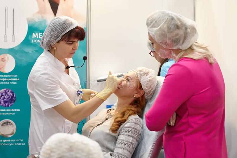 An experienced cosmetologist surgeon conducts training in demons royalty free stock images