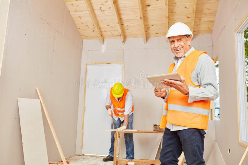 Experienced craftsman with carpenter stock photography