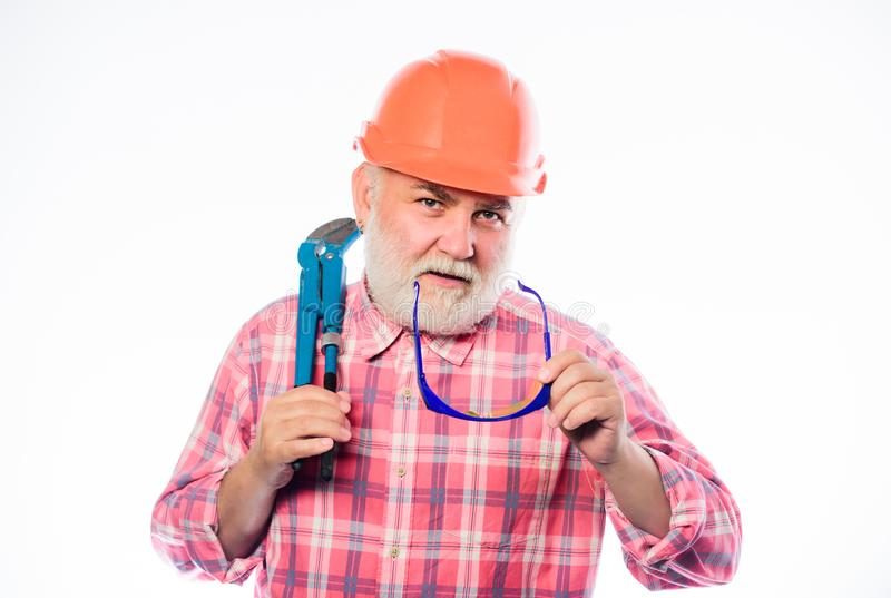 Experienced engineer. Home improvement. Plumber service. Man bearded plumber wear helmet and hold wrench tool. Repair royalty free stock photo