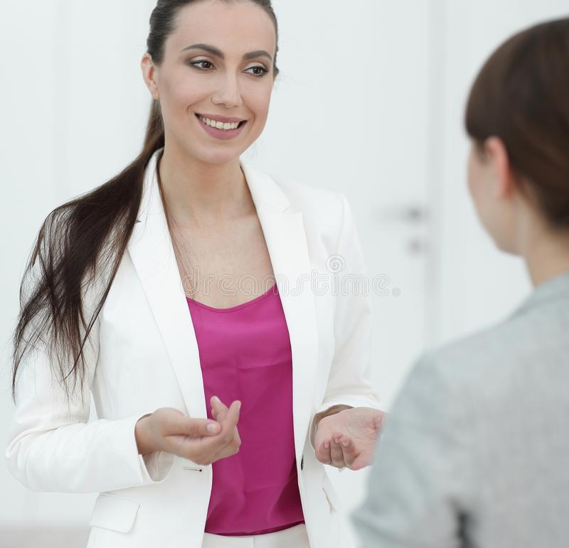 Experienced female Manager talking to a customer royalty free stock images