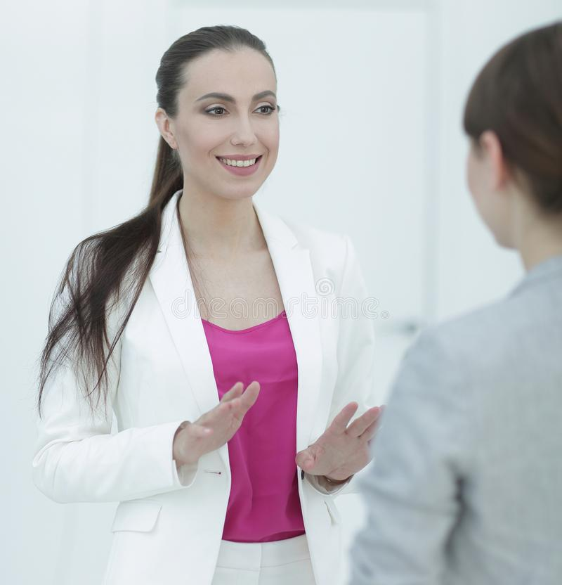 Experienced female Manager talking to a customer royalty free stock photo
