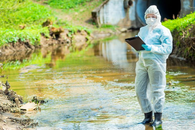 An experienced scientist ecologist, biologist conducting research environment. Pollution stock image