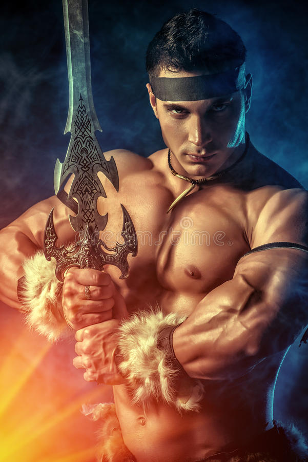 Experienced warrior. Portrait of a handsome muscular ancient warrior with a sword royalty free stock photos