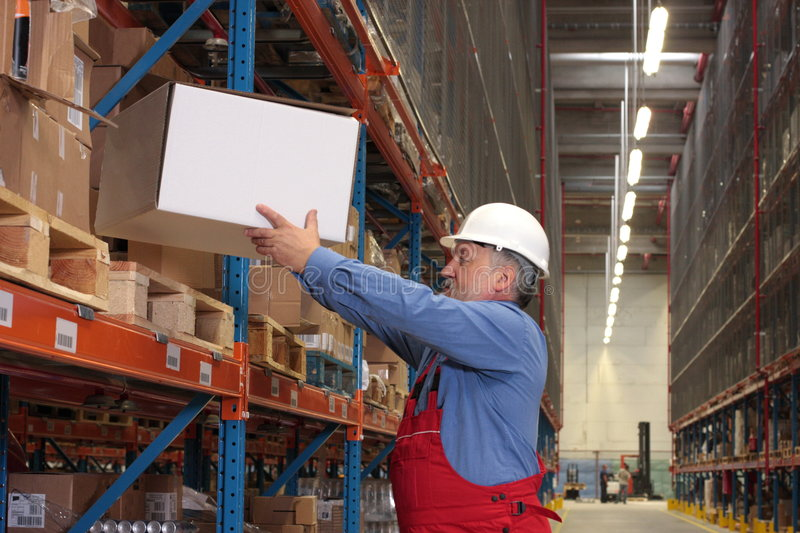 Experienced worker with box royalty free stock image