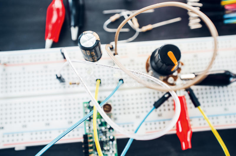 Experiment with electronic components close-up. Breadboard with wires and connectors. Students experience in laboratory stock photo