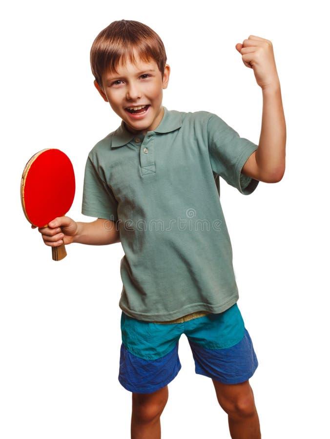 Experimentação do menino do pong do sibilo do atleta do tênis de mesa foto de stock