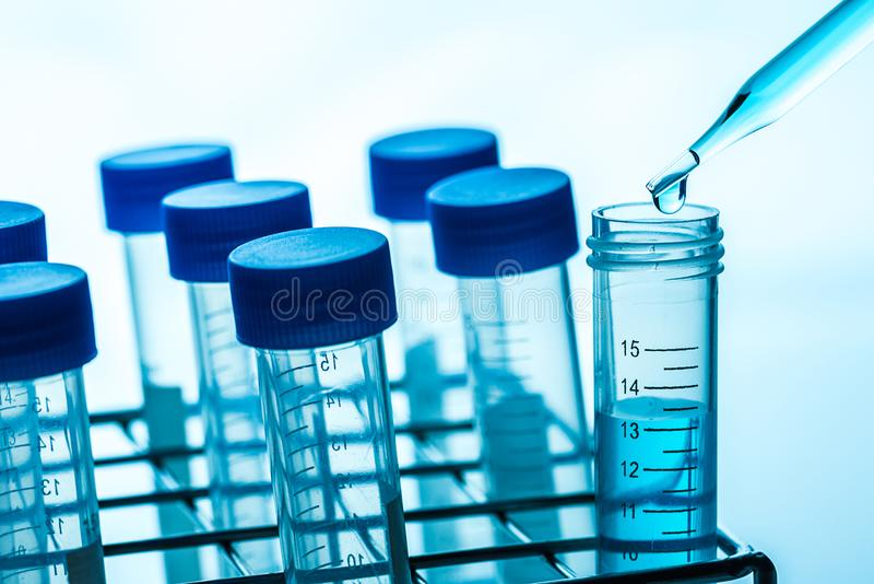 Experimental drops over science laboratory test tubes , science stock images